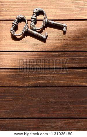 Vintage keys on a wooden background