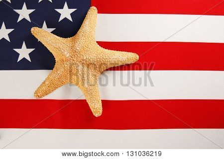 Labor day concept. Starfish on USA national flag background