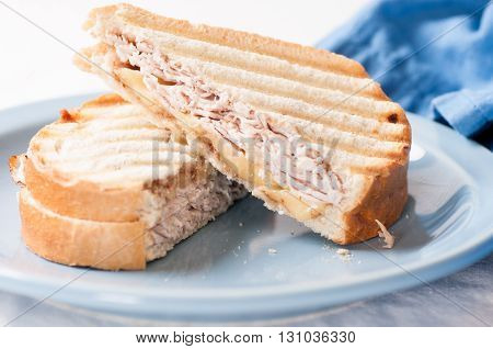 quicly made home panini with turkey and cheese sandwich