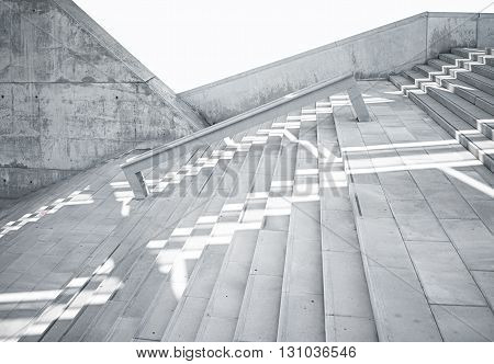 Horizontal Photo Blank Grungy and Smooth Bare Concrete Stairs with White Sunrays Reflecting on Surface. Empty Abstract background. Modern Architecture Building.