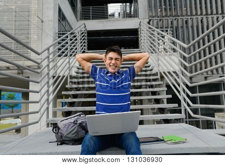 Asian student sitting use laptop at campus