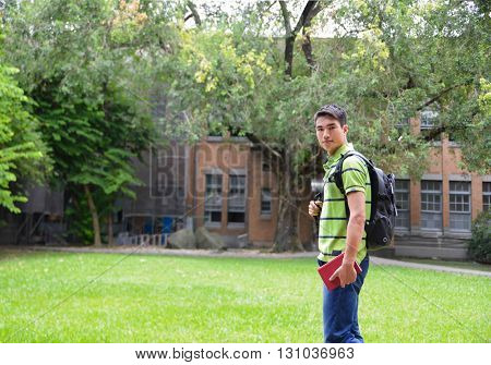 portrait of male college student standing at campus
