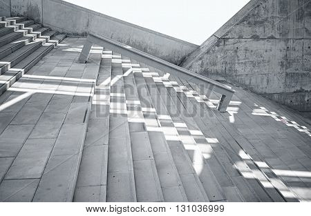 Horizontal Photo Blank Grungy Smooth Bare Concrete Wall with Sunrays Reflecting on Surface. Soft shadows. Empty Abstract background. Black and White.