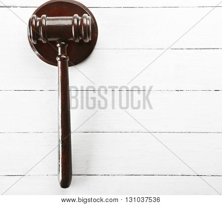 Gavel on wooden background