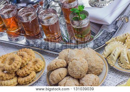 Bowl of Moroccan harira soupchebakia dates for iftar