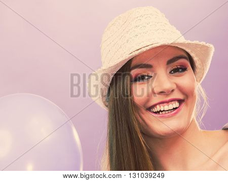 Closeup of partying girl. Young woman holding balloons. Celebration entertainment concept.