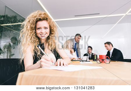 Business woman portrait in an office. Smiling successful business woman
