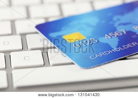 Credit card on keyboard, close up