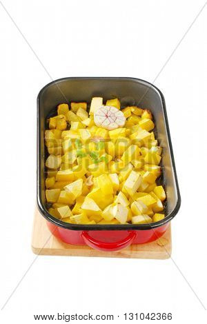 Diced pumpkin roasted with garlic in a baking pan