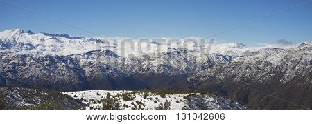 Winter snow covering the mountains surrounding Santiago, capital city of Chile. Viewed from Cerro Pochoco.