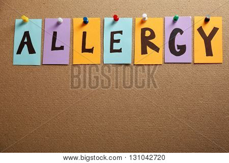 Word ALLERGY pinned on textured background