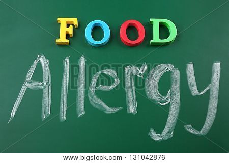 Text FOOD ALLERGY on blackboard background