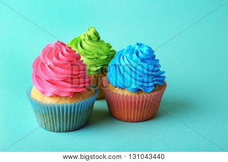 Birthday cupcakes on turquoise background