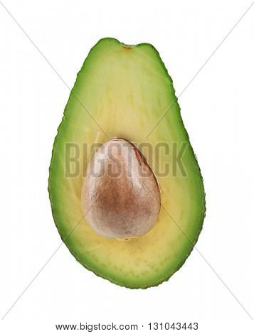 Half of fresh avocado with stone isolated on white