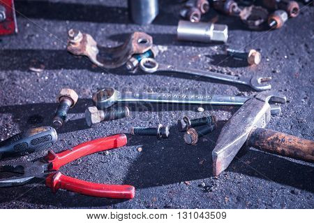 Mechanical automotive fixing engineering industry concept. Pliers wrench screwdriver on table. Bunch of hand tools in workshop.