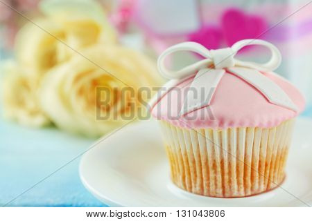 Happy Mother's day concept. Cupcake on a plate.