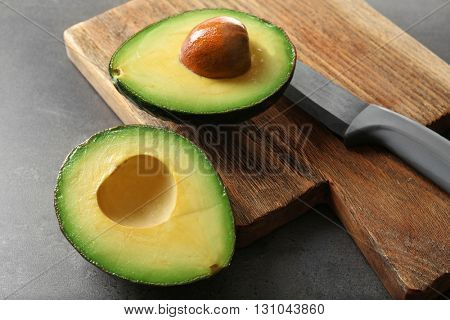 Fresh avocado on cutting board, closeup