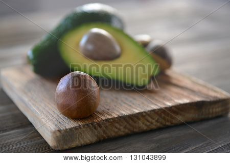 Avocado seed on cutting board, closeup