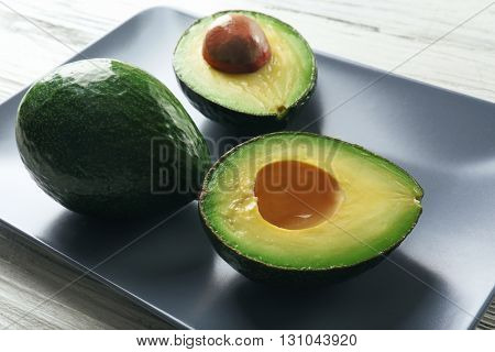 Fresh avocado on a plate, closeup