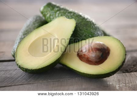 Fresh avocados on wooden background
