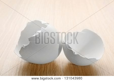 Cracked egg shell on wooden background
