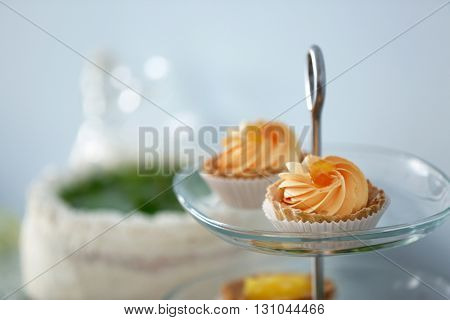 Delicious dessert on a glass stand