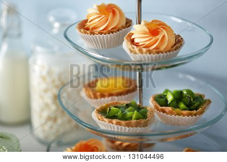 Delicious desserts  on a glass stand
