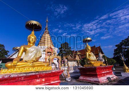 thai golden buddha statue with pagoda , art