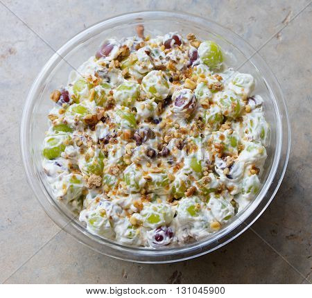 Freshly made grape salad with walnuts and brown sugar sprinkled on top