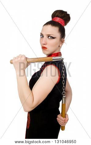 Funny woman with nunchucks isolated on white