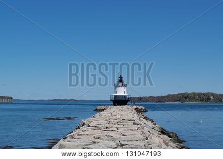 Light house at end of sea wall