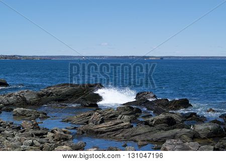waves breaking along a rocky shore line
