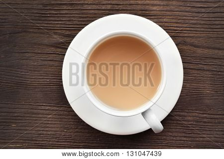 Milk tea on wooden background.