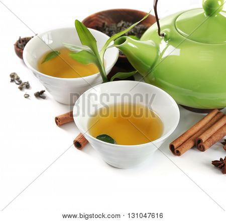 Green tea with utensils and spices, isolated on white