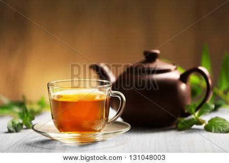 Cup of tea and teapot on table
