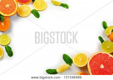 Fresh mixed citrus fruit including   lemons, limes, grapefruits, oranges, tangerines and mint sprigs isolated on white background, top view