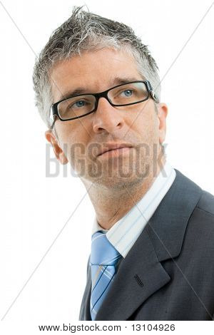 Closeup portrait of serious businessman wearing gray suit with blue tie and glasses. Isolated on white background.