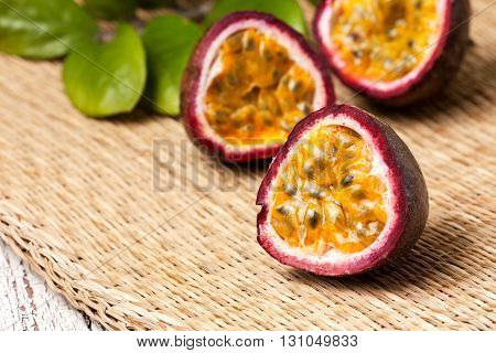 tropical fruit passion fruit on straw background