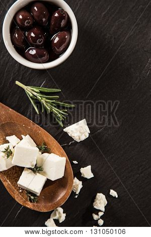 Diced feta with olives, close-up.
