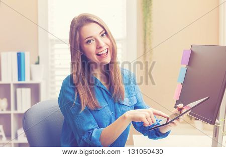 Happy Young Woman Using Her Tablet Computer