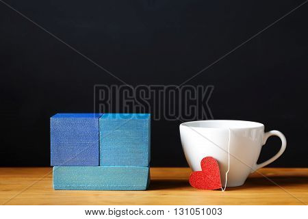 A coffee cup with colorful blue wooden blocks