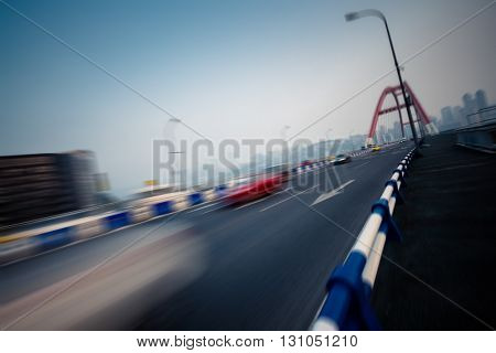 motion blurred traffic on bridge,chongqing china.