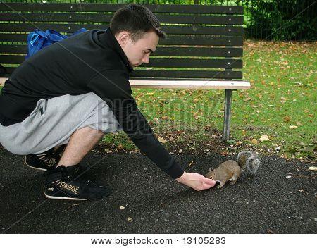 Guj Feeds Squirrel In London Park