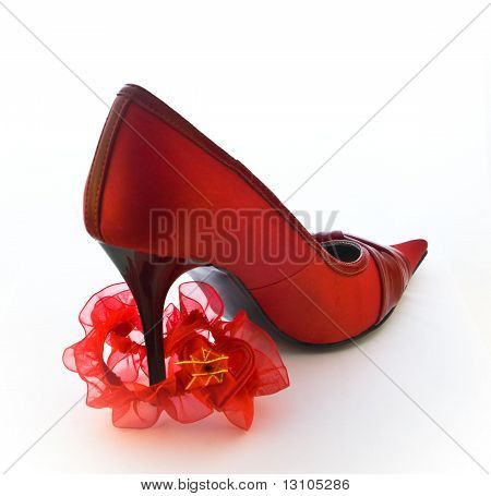 Red Shoe With Red Garter For Stocking On White Background