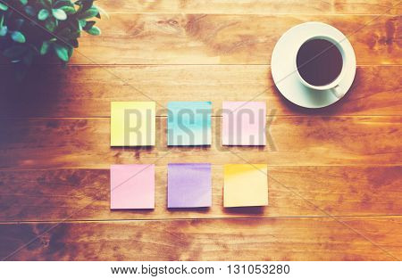 Person Organizing Things With Pastel Sticky Notes