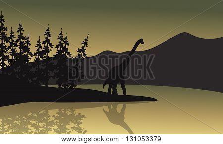 Silhouette of brachiosaurus in riverbank a beautiful scenery