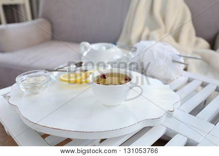 Tea set on a white wooden tray