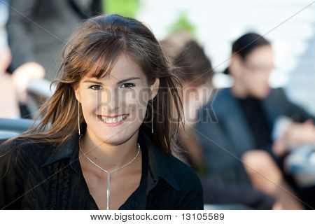 Closeup portrait of happy young businesswoman, smiling.