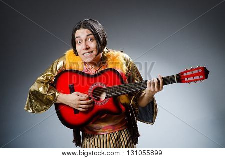 Man with guitar in musical concept