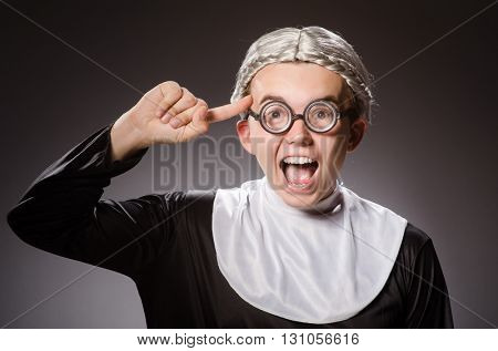 Funny man wearing nun clothing
